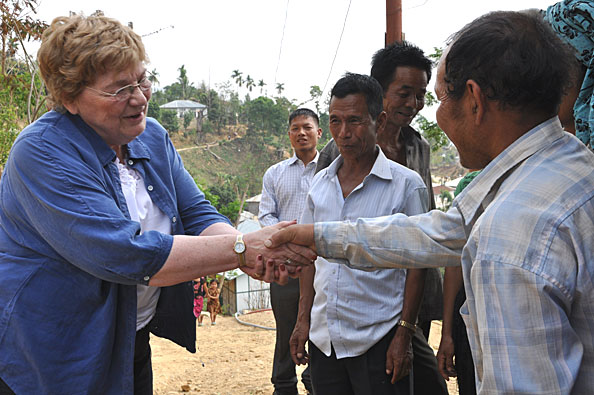Sandy greeted by the village leaders