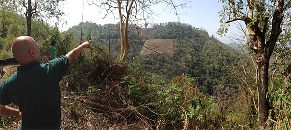 John Pudaite pointing to Sesawng Mountain