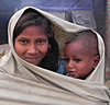 Girl & Boy Wrapped In Blanket